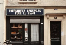 Partial screen cap from the movie of a piano parts store in Paris
